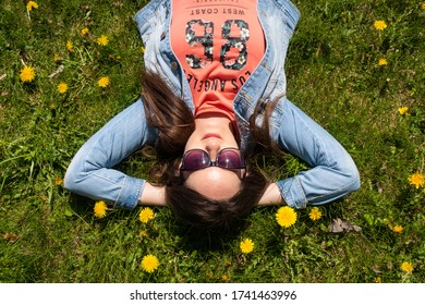 young-woman-sunglasses-lying-on-260nw-17