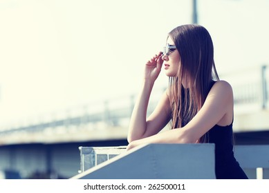 young woman in sunglasses outdoor