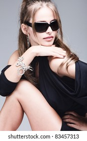 young woman with sunglasses studio portrait