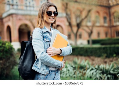 Young woman in sunglasses at university campus