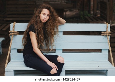 young woman in sunglasses. young woman walking on the street. Girl in black. Matures glasses. Hooligan in the yard. Black clothes. portrait of young woman. Hooligan on the street. Street residents