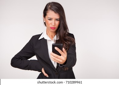 young woman surprise expression holding a phone