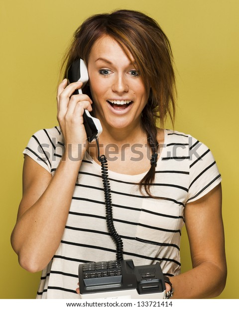 Young woman is surprised on the phone.
