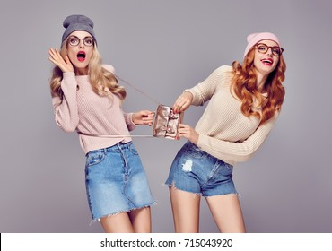 Young Woman Surprised Smiling. Having Fun Crazy. Fashion. Two Pretty Sisters Best Friends Twins in Stylish Autumn Winter Outfit. Playful Hipster Girls. Cool Blond Redhead