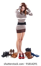 young woman surrounded by shoes, isolated on white