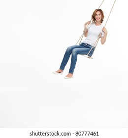 young woman swinging alone on a swing