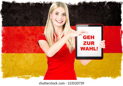 Young woman with Tablet PC and Germany flag on background. Sample text Vote!