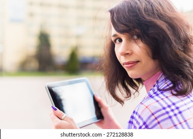 Young woman with Tablet reading from ebook