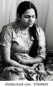 A young woman takes part in a pre-wedding ceremony
