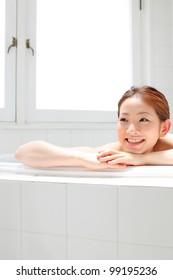 young woman taking bath