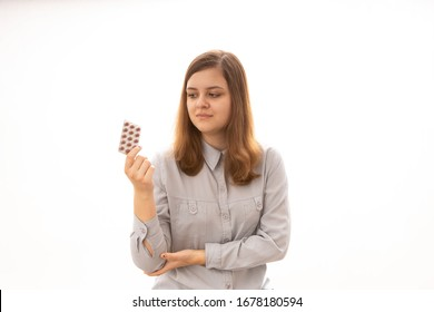young woman taking medicine isolated on white