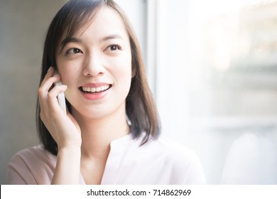 Young woman taking on smart phone