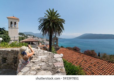 Young Woman Taking Pictures with Mobile Phone in Herceg Novi, Montenegro
