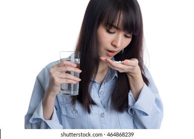 Young woman taking pill or drug with glass of water, health and medicine concepts, isolated on white background