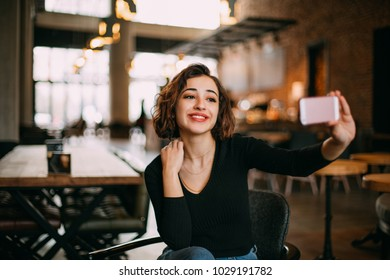 Young Woman Taking Self Portrait with Phone