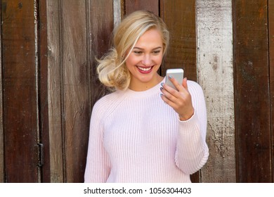 Young woman taking selfie.