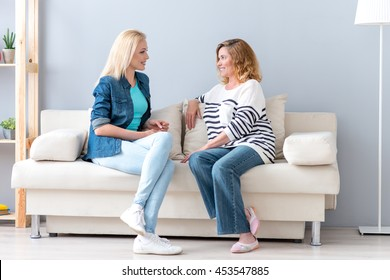 Young woman talking with her parent