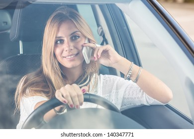 Young Woman Talking on Mobile while Driving