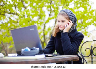young woman talking on phone outdoor