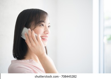 Young woman talking on  smart phone.