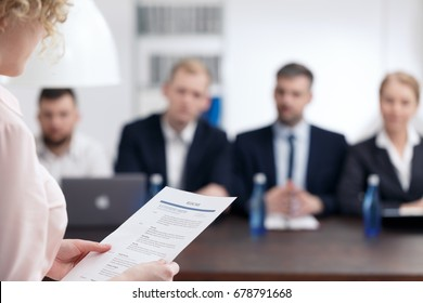 Young woman talking with recruitment committee in big enterprise