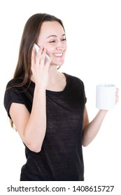 young woman talking with smartphone in hand and cup mug of tea coffee on white background