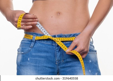 a young woman with a tape measure prior to the next diet. dieting and fasting