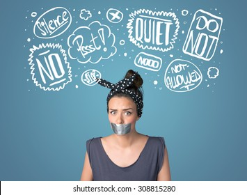 Young woman with taped mouth and white drawn thought clouds around her head
