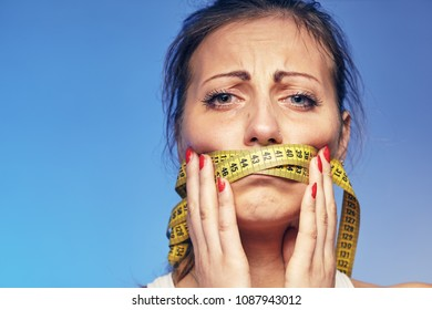 a young woman with a taped tape on the lips. She is worried about the diet.