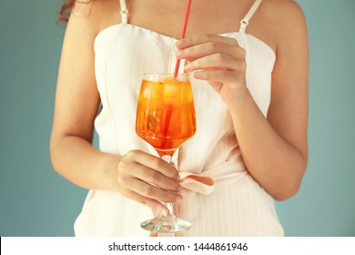 Young woman with tasty summer cocktail, closeup