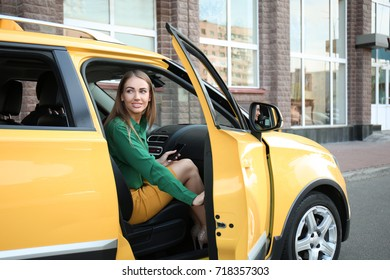 Young woman in taxi car