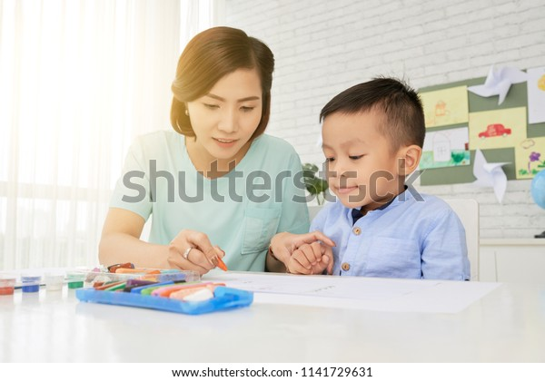 Young Woman Teacher Cute Asian Boy Stock Photo Edit Now