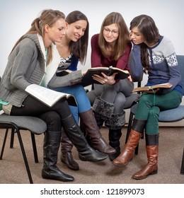 Young woman teacher teach God's Words to a women team
