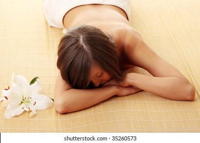 Young woman (teen girl) relaxing in massage