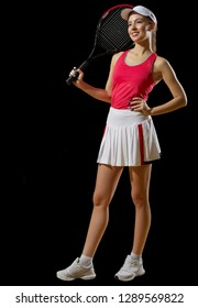 Young woman tennis player isolated on black