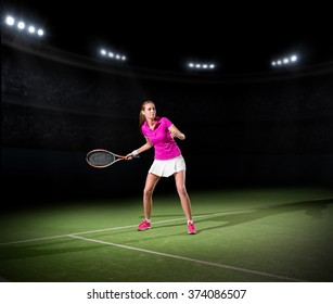 Young woman tennis player on court