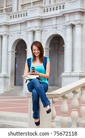 young woman texting on school campus