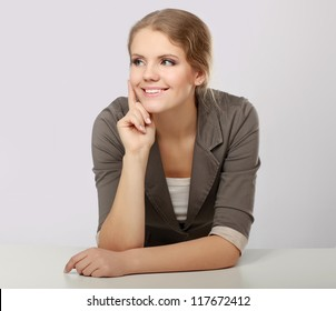A young woman thinking isolated on white background