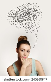 Young woman with thoughts clouds above her head, Portrait of young woman with confusing thoughts