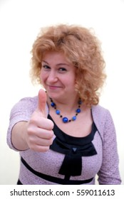 Young woman thumbs up