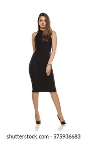 young woman in tight black dress on white background