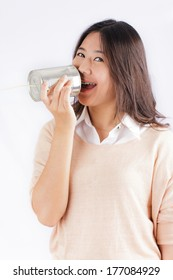 Young woman with tin can telephone