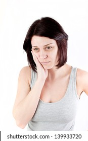 young woman with tooth ache making massage to avoid pain