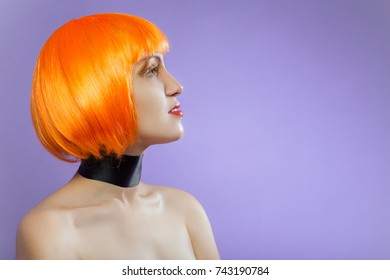 young woman topless in red wig on violet background with copy space