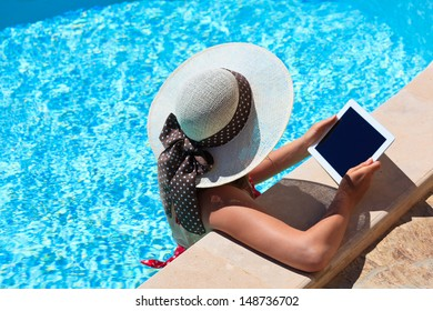 young woman with touch pad on vacation