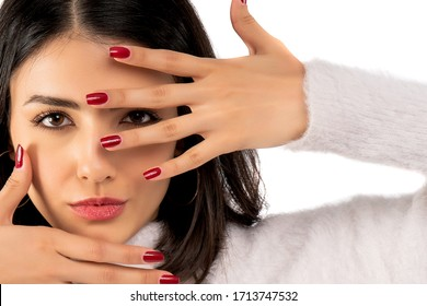 Young woman touching her face isolated on white background. Close-up of woman face.