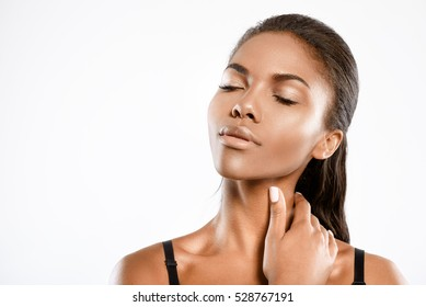 Young woman is touching her neck with tenderness