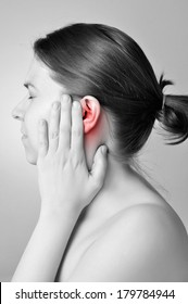 Young woman touching her painful ear