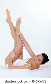 Young woman touching her smooth legs