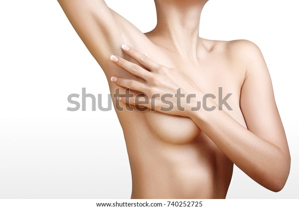 Young Woman Touching her soft Armpit. Perfect Shapes of Female Body. Health Care breast. Clean Shaving, Epilation or sugaring